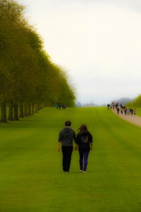 A Couple Walking Across the Lawn